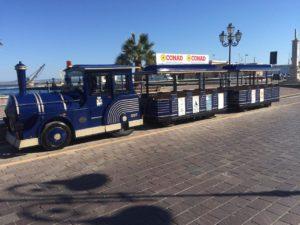 """In occasione della 2ª """"Festa del Patrimonio"""", sabato 18 e domenica 19 maggio, turisti e residenti potranno ammirare la città di Carbonia a bordo di un caratteristico trenino gommato."""